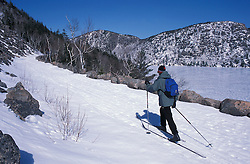 Acadia National Park, ME..Cross country skiing on the Carriage Roads next to Jordan Pond and the Bubbles.