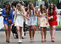 Racegoers arriving at Ladies Day at Glorious Goodwood, Thursday, 2nd August 2012  Photo by: Stephen Lock / i-Images