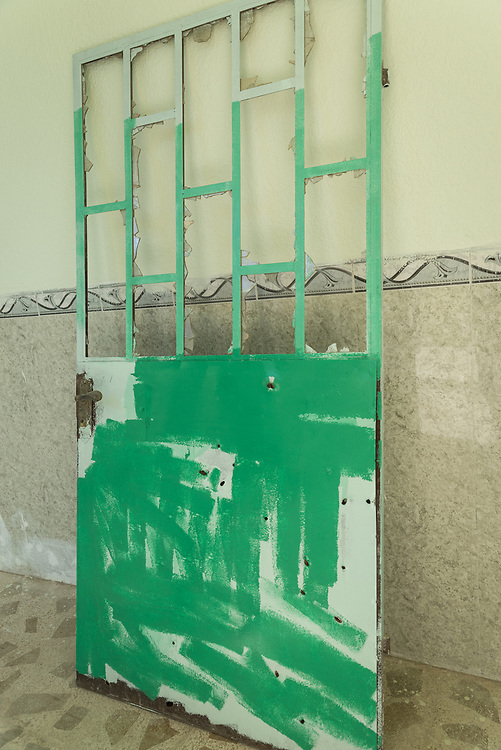 11 October 2017 &ndash; Ninewa Plains &ndash; Iraq &ndash; An old damaged door with many bullet holes at the Rasen Primary Mixed School in the Alhamdain Sub District in the Ninewa Plains. <br /> <br /> UNDP&rsquo;s Funding Facility for Stabilization is helping rehabilitate the school, which now has all new doors.  <br /> <br /> &copy; UNDP Iraq / Claire Thomas