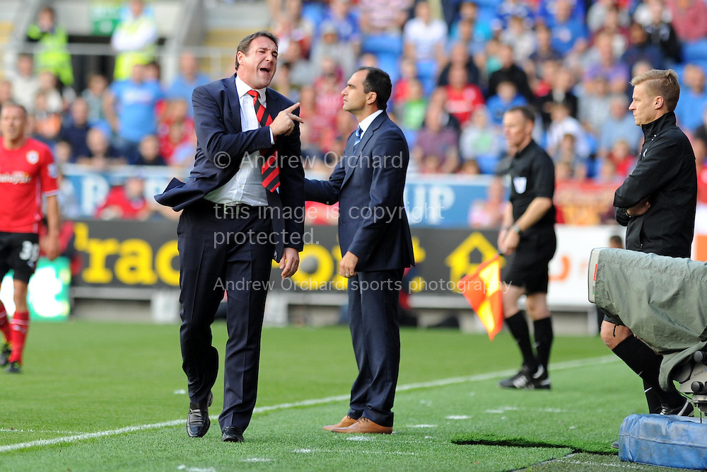 Cardiff city manager Malky Mackay shows his frustrations.   Barclays Premier league, Cardiff city v Everton at the Cardiff city Stadium in Cardiff,  South Wales on Saturday 31st August 2013. pic by Andrew Orchard,  Andrew Orchard sports photography,