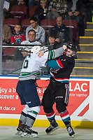 KELOWNA, CANADA - OCTOBER 10:  Nolan Volcan #26 of the Seattle Thunderbirds drops the gloves with Erik Gardiner #11 of the Kelowna Rockets during second period on October 10, 2018 at Prospera Place in Kelowna, British Columbia, Canada.  (Photo by Marissa Baecker/Shoot the Breeze)  *** Local Caption ***