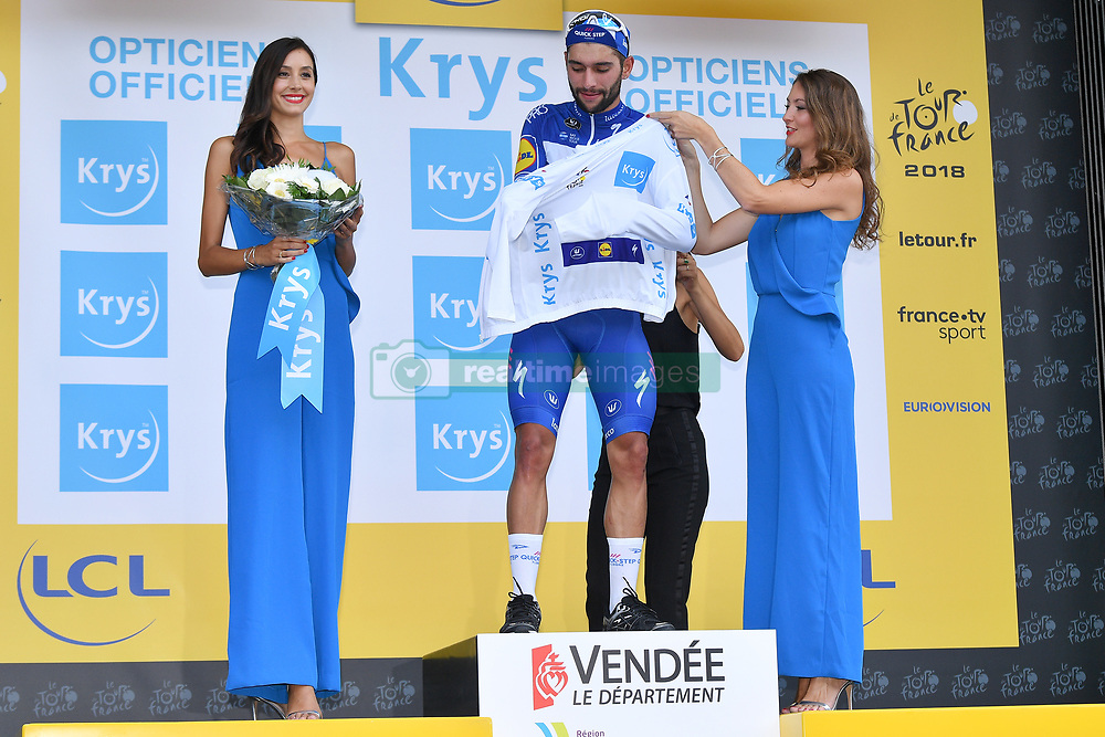 July 7, 2018 - Fontenay-Le-Comte, FRANCE - Colombian Fernando Gaviria of Quick-Step Floors celebrates on the podium in the white jersey for best young rider after the first stage of the 105th edition of the Tour de France cycling race, 201km from Noirmoutier-en-l'Ile to Fontenay-le-Comte, France, Saturday 07 July 2018. This year's Tour de France takes place from July 7th to July 29th. BELGA PHOTO DAVID STOCKMAN (Credit Image: © David Stockman/Belga via ZUMA Press)