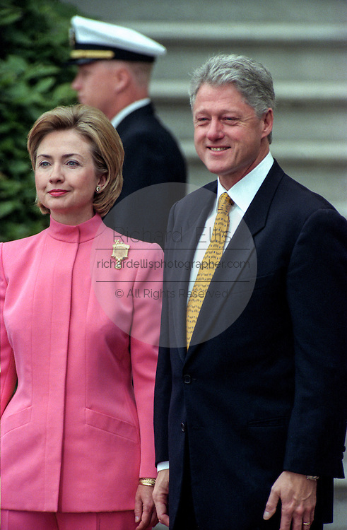 US President Bill Clinton and First Lady Hillary Rodham Clinton wait the arrival of Colombian President Andres Pastrana and his wife, First Lady Nohra for a State Visit on the South Lawn of the White House October 28, 1998 in Washington DC.