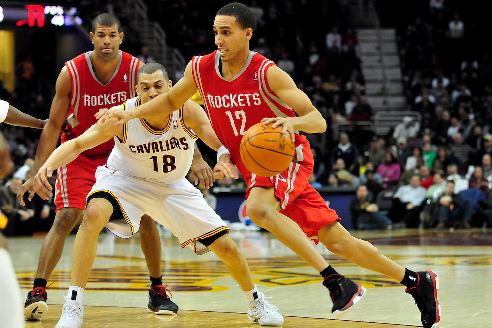 Feb. 23, 2011; Cleveland, OH, USA; Houston Rockets shooting guard Kevin Martin (12) drives past Cleveland Cavaliers shooting guard Anthony Parker (18) during the fourth quarter at Quicken Loans Arena. The Rockets beat the Cavaliers 124-119. Mandatory Credit: Jason Miller-US PRESSWIRE