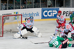 Ziga Pance (HDD Tilia Olimpija, #19) vs Michal Fikrt (HK Acroni Jesenice, #37) during ice-hockey match between HDD Tilia Olimpija and HK Acroni Jesenice in second game of Final at Slovenian National League, on April 3, 2011 at Hala Tivoli, Ljubljana, Slovenia. (Photo By Matic Klansek Velej / Sportida.com)