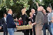 Prinses M&aacute;xima bezoekt Buurtvereniging Hoofdstraat-Noord in Gasselternijveen. Deze buurtvereniging organiseert verschillende sociale activiteiten rondom een cultuurhistorische perenbomenrij in de straat. In mei 2012 won de buurtvereniging een Appeltje van Oranje. ///// Princess M&aacute;xima visits the neighborhood association in Gasselternijveen. This neighborhood association organizes various social activities around a historic pear row of trees in the street. In May 2012 won the neighborhood association Apple of Orange.<br /> <br /> Op de foto/ On the photo:  Prinses Maxima krijgt uitleg bij de perenbomen / Princess Maxima receives explanation on peartreas