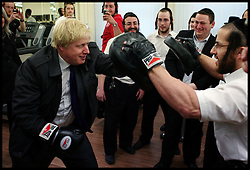The London Mayor Boris Johnson sparring with the owner of a gym in Stamford Hill, London, UK, Thursday April 5, 2012. Photo By Andrew Parsons/ i-Images...