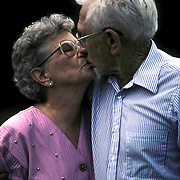 "Affectionate senior married couple of 45 years, kissing...Kissing is ""natural"" and ""normal"" in our culture. It is an expression of intimacy, love, and passion for young and old, heterosexual persons. Intimacy and sexual interactions are important to us throughout our lives."