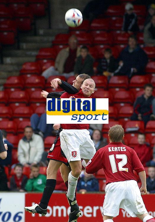 Photo: Dave Linney.<br />Walsall v Milton Keynes Dons. Coca Cola League 2. 28/10/2006.  Walsall's Michael Dobson( R) battles for the ball with  Dean Lewington