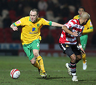 Doncaster - Friday January 30th 2009:Lee Croft of Norwich City & James Chambers of Doncaster Rovers in action during the Coca Cola Championship Match at The Keepmoat Stadium Doncaster. (Pic by Steven Price/Focus Images)