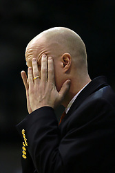 19 March 2010: Coach Brian Morehouse tries to clear his head. The Flying Dutch of Hope College defeat the Yellowjackets of the University of Rochester in the semi-final round of the Division 3 Women's Basketball Championship by a score of 86-75 at the Shirk Center at Illinois Wesleyan in Bloomington Illinois.