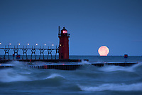 The full moon melts into Lake Michigan