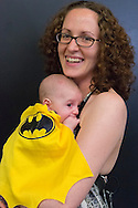 Garden City, New York, U.S. - June 14, 2014 - DANA MONTANO HARITOS is holding her two-month-old baby son dressed as BAT BABY, wearing a yellow and black bat cape and suit, at Eternal Con, the annual Pop Culture Expo, with costumes, Comic Books, Collectibles, Gaming, Sci-Fi, Cosplay, Horror, and held at the Cradle of Aviation Museum on Long Island.