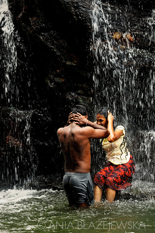 Sri Lanka, Ella. Young couple in the waterfall Rawana Ella Falls.