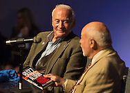 """May 11, 2013 - Garden City, New York U.S. -  Astronaut BUZZ ALDRIN, at left, the second person to walk on the moon, is in conversation with DICK DUNNE, who is holding one of Aldrin's new books """"Mission to Mars.""""  The lecture in the JetBlue Sky Theater Planetarium by Aldrin, the NASA astronaut engineer of Apollo 11 in 1969, was Sold Out, but people who bought this book or his illustrated history of space exploration """"Look to the Stars"""" at the Cradle of Aviation Museum's book store could attend the book signing."""