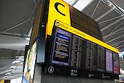 International flight departure information board at Zone c, in upper level of departures concourse, Heathrow Terminal 5.