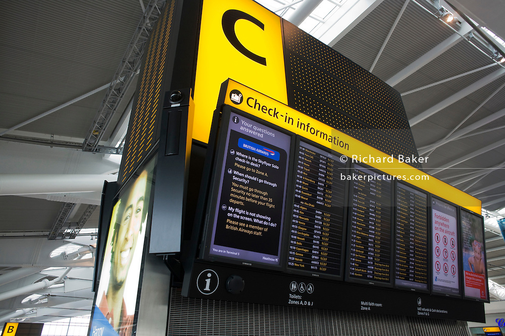 International flight departure information board at Zone c, in upper level of departures concourse, Heathrow Terminal 5.