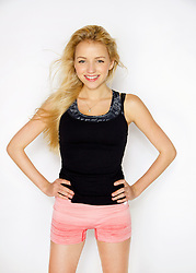 Young Woman with Hands on Hips Smiling