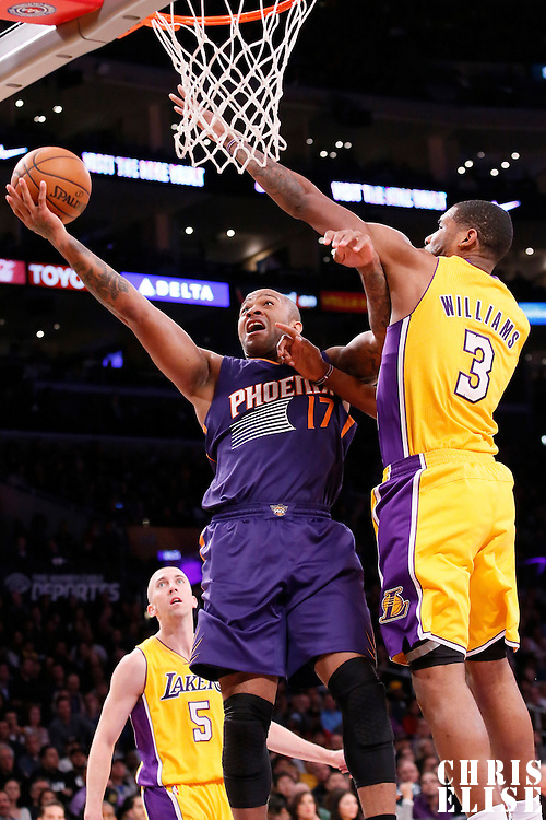 10 December 2013: Phoenix Suns small forward P.J. Tucker (17) goes for the layup past Los Angeles Lakers power forward Shawne Williams (3) during the Phoenix Suns 114-108 victory over the Los Angeles Lakers at the Staples Center, Los Angeles, California, USA.