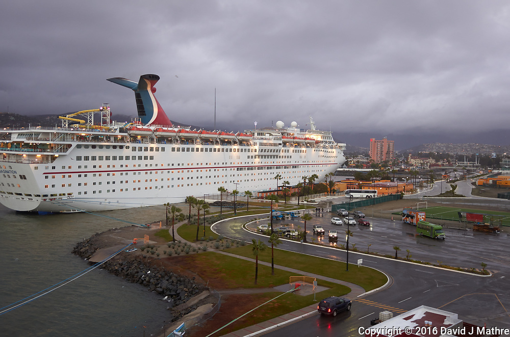 "(Image two of nine) Panorama of the Ensenada harbor in Mexico on a grey and raining day from the deck of the MV World Odyssey. The other cruse ship is the Carnival Imagination. Once all of the students, faculty, staff, and life long learners were aboard we would be ready to begin the 102 day ""round the world"" Semester at Sea Spring 2016 Voyage. Composite of nine images taken with a Leica T camera and 23 mm f/2 lens (ISO 250, 23 mm, f/2, 1/80 sec). Panorama stitched using AutoPano Giga Pro."