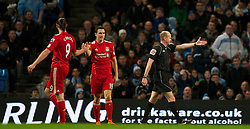 11.01.2012, Etihad Stadion, Manchester, ENG, Carling Cup, Manchester City vs FC Liverpool, Halbfinale, im Bild Referee Lee Mason points at the penalty spot, as Liverpool's Stewart Downing and Andy Carroll celebrate, during the football match of English Carling Cup, Halffinal, between Manchester City and FC Liverpool at Etihad Stadium, Manchester, United Kingdom on 2012/01/11. EXPA Pictures © 2012, PhotoCredit: EXPA/ Propagandaphoto/ David Rawcliff..***** ATTENTION - OUT OF ENG, GBR, UK *****