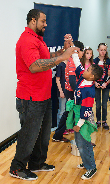 Houston Texans All-Pro offensive tackle Duane Brown leads a pep rally for the students of West University Elementary School to congratulate them for collecting more than 30,908 pounds of food for the Souper Bowl of Caring. It was the fourth consecutive year the school collected the most food nation wide.