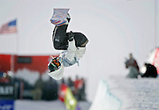 Hannah Teter of Belmont, Vt. flips out of the halfpipe during the halfpipe finals at the Chevrolet U.S. Snowboard Grand Prix in Breckenridge, Co. Saturday December 17, 2005. The Breckenridge event was the first of three stops in a series that will determine who will make the U.S. Snowboard Team and represent the country in the 2006 Winter Olympics in Torino, Italy. Shaun White of Carlsbad, Ca. won the men's event while Gretchen Bleiler of Snowmass Village, Co. won the women's event. The Grand Prix, now in its 10th year as the premier snowboard series in North America, features a cash purse of $340,000 and a new Chevrolet truck to the overall male and female winner of the series. Teter won the first halfpipe event but finished 5th in the second event with a score of 31.90..(MARC PISCOTTY/ © 2006)