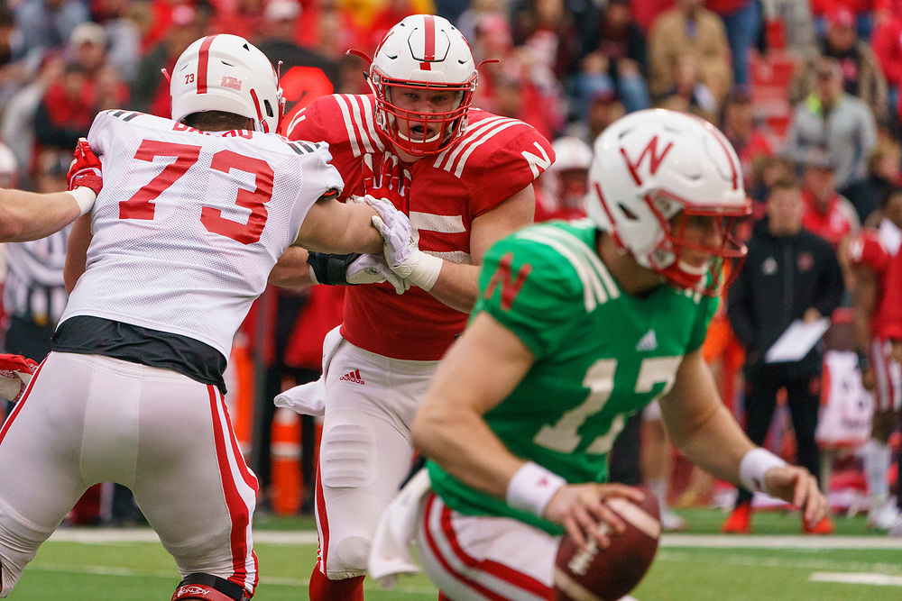 Ben Stille #95 chases Noah Vedral #17 during Nebraska's annual Spring Game at Memorial Stadium in Lincoln, Neb., on April 21, 2018. © Aaron Babcock