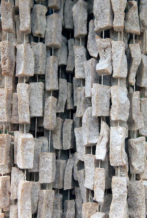 Asia, Bhutan, Wengdue. Yak Cheese, smoked and dried, hangs at roadside spots in Bhutan.