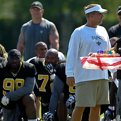 July 31, 2011; Metairie, LA, USA; New Orleans Saints head coach Sean Payton has Shirley Temple drinks brought out for the recently signed veterans that are not yet allowed to practice during training camp practice at the New Orleans Saints practice facility. Mandatory Credit: Derick E. Hingle