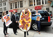 Presidential candidate Loaded Potato Skin, the iconic appetizer from TGI Fridays, greets supporters in New York, Tuesday, July 21, 2015.  Mr. Potato Skin is the 16th candidate in an already crowded field, and while not affiliated with any political party, he knows how to party and is prepared to prove it.  Mr. Potato Skin encourages supporters to visit www.skin4president.com and use #PotatoPOTUS and #PotatoInChief in social conversations.  (Photo by Diane Bondareff/Invision for TGI Fridays/AP Images)