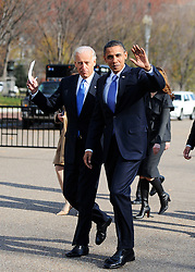 """File photo dated December 2, 2010 of President Barack Obama and Vice President Joe Biden cross Pennsylvania Avenue to attend a meeting with newly elected governors at the Blair House in Washington, DC. Former President Barack Obama endorsed Joe Biden, his two-term vice president, on Tuesday morning in the race for the White House. """"Choosing Joe to be my vice president was one of the best decisions I ever made, and he became a close friend. And I believe Joe has all the qualities we need in a president right now,"""" Obama said in a video posted to Twitter. Photo by Olivier Douliery /ABACAPRESS.COM"""