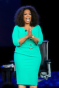 "Oprah Winfrey and Bishop T.D. Jakes speak during a live taping of ""Oprah's Lifeclass"" during Mega-Fest 2013 at the American Airlines Center in Dallas, Texas on August 29, 2013."