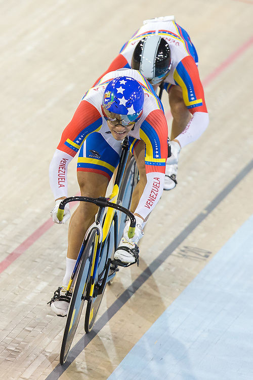 Cesar Marcano Sanchez of Venezuela leads his team during the gold medal race in the men's team sprint at the 2015 Pan American Games in Toronto, Canada, July 16,  2015. Canada defeated Venezuela to take the gold medal. AFP PHOTO/GEOFF ROBINS