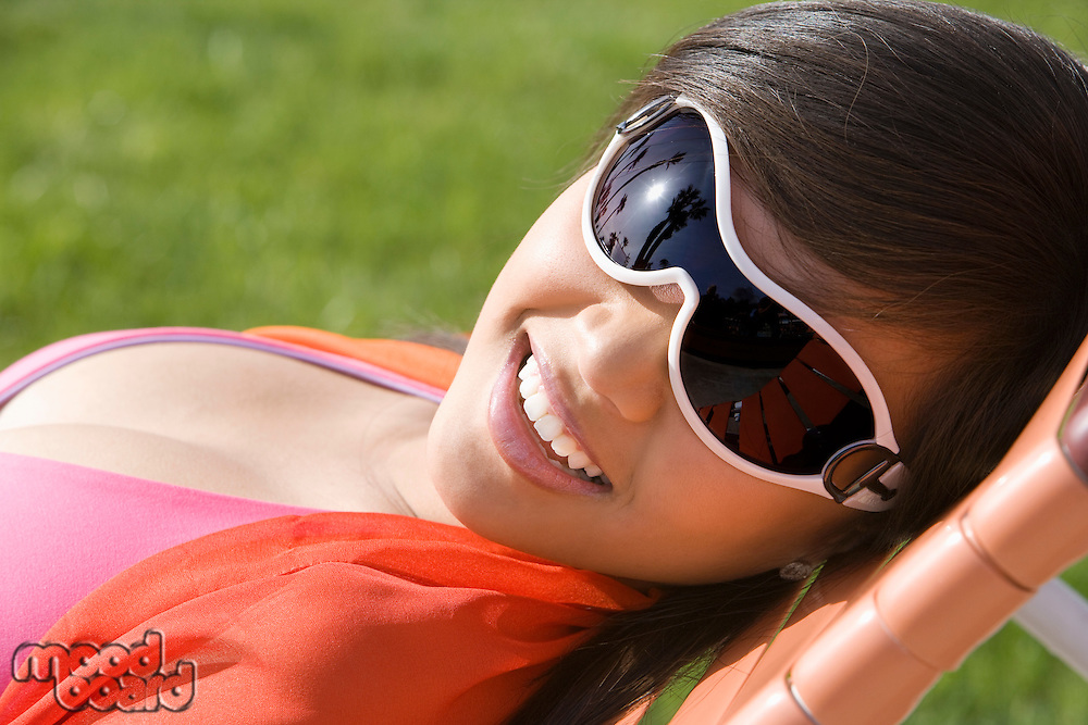 Young Woman Relaxing in Park, Portrait