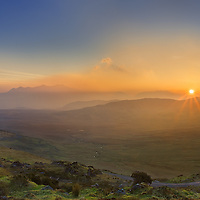 Misty Sunrise over Macgillycuddys Reeks with view on Carrantuohill and green valley - Tourist Attraction Ballaghsheen Pass, county Kerry, Ireland / ba069