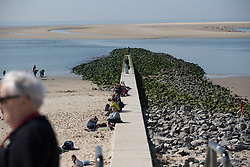 Locals enjoy the sunshine on the beach during Stage 5 of the Healthy Ageing Tour - a 117.9 km road race, starting and finishing in Borkum on April 9, 2017, in Groeningen, Netherlands.