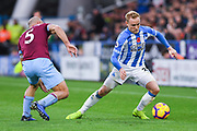 Alex Pritchard of Huddersfield Town (21) takes on Pablo Zabaleta of West Ham United (5) during the Premier League match between Huddersfield Town and West Ham United at the John Smiths Stadium, Huddersfield, England on 10 November 2018.