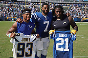 Sep 8, 2019; Carson, CA, USA; Indianapolis Colts running back Nyheim Hines (left) and \Los Angeles Chargers defensive tackle Justin Jones  pose with Indianapolis Colts quarterback Jacoby Brissett (7) after exchanging jerseys after the game at Dignity Health Sports Park. The Chargers defeated the Colts 30-24 in overtime.