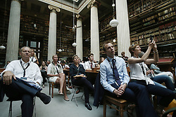 September 16, 2016 - Athens, Attica, Greece - Delegates attend the session : Google Hangout, Privacy vs Security, in the context of the fourth annual Athens Democracy Forum. During the session  Edward Snowden, former US intelligence officer and whistleblower, spoke via video link, at the National Library of Greece, on September 16, 2016, (Credit Image: © Panayiotis Tzamaros/NurPhoto via ZUMA Press)