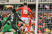 Barnsley midfielder, on loan from Manchester United, Ben Pearson  buddies the ball over the line during the Johnstone's Paint Trophy match between Barnsley and York City at Oakwell, Barnsley, England on 10 November 2015. Photo by Simon Davies.