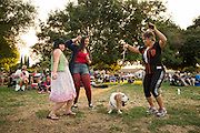 From left to right, Shasha Adao, Alexis Marquez, Carmella the hound, and Rocky Marquez dance as Big Blu Soul Revue performs during the City of Milpitas Summer Concert Series at Murphy Park in Milpitas, California, on July 26, 2016. (Stan Olszewski/SOSKIphoto)