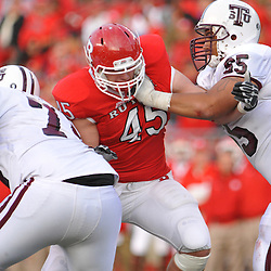 Oct 10, 2009; Piscataway, NJ, USA; Rutgers defensive end Alex Silvestro (45) battles Texas Southern offensive lineman Skylar Trimble (65) during second half NCAA college football action in Rutgers' 42-0 victory over Texas Southern at Rutgers Stadium.