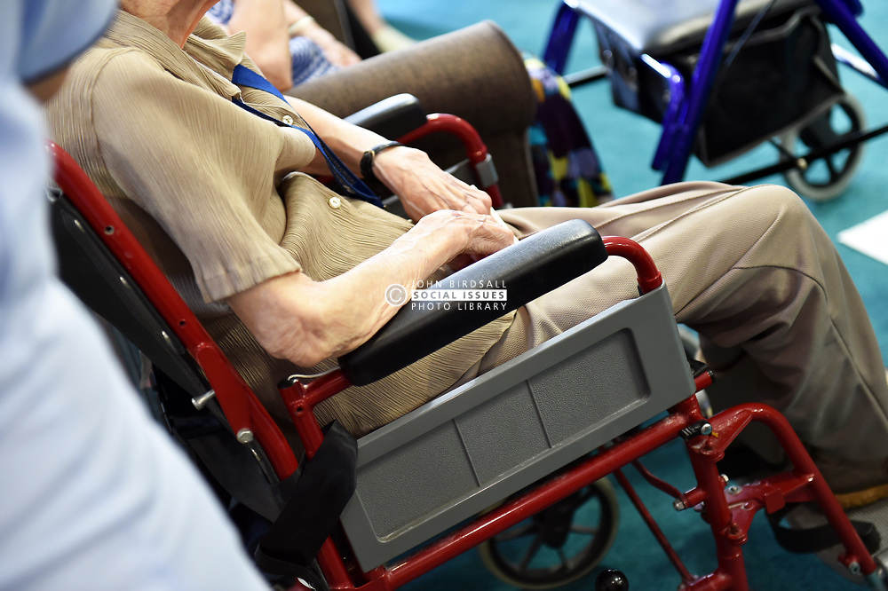 wheel chair elderly person care home caring residential old aged