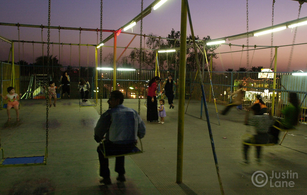 09/29--Baghdad, Iraq--Nightlife is a bit limited in Baghdad given certain cultural norms and security conocrens. HERE, visitors to Rayhana Cafe in Baghdad enjoy swings.