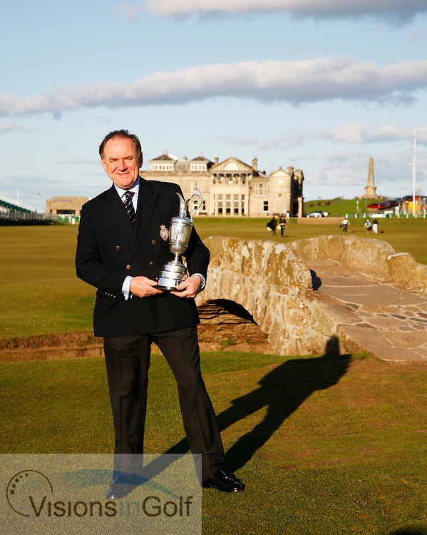 Peter Dawson, Chief Executive of the R&amp;A with the Open Championship Trophy by the Swilken Bridge at St. Andrews.<br /> Picture Credit: Mark Newcombe / visionsingolf.com