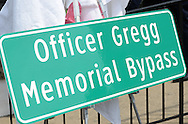 NEWTOWN, PA - APRIL 22:  The new sign is seen during a dedication ceremony to rename part of the Newtown Bypass in honor of former Newtown Borough Police Officer Brian Gregg at Newtown Borough Hall April 22, 2014 in Newtown, Pennsylvania. Gregg was killed in the line of duty during the shootings at St. Mary Medical Center in 2005. (Photo by William Thomas Cain/Cain Images)