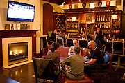 Visitors watch the Dallas Mavericks on a television while having a drink at the Kennedy Room on Friday, January 18, 2013 in Dallas, Tx. (Cooper Neill/The Dallas Morning News)