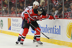 Jan 25, 2013; Newark, NJ, USA; New Jersey Devils left wing Patrik Elias (26) and Washington Capitals defenseman Roman Hamrlik (44) battle for the loose puck during the first period at the Prudential Center.