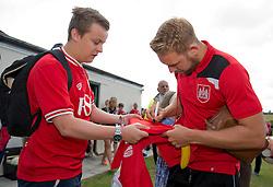 Scott Wagstaff of Bristol City signs a shirt for a fan as Bristol City play a Community match against Brislington and Keynsham Town - Photo mandatory by-line: Dougie Allward/JMP - Mobile: 07966 386802 - 05/07/2015 - SPORT - Football - Bristol - Brislington Stadium - Pre-Season Friendly